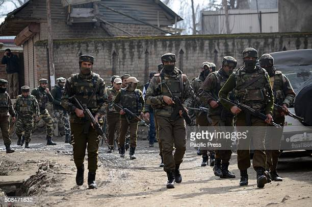 A special operation group soldier runs for cover near the encounter site after heavy exchange of firing in Hajin Village of Bandipora some 35...