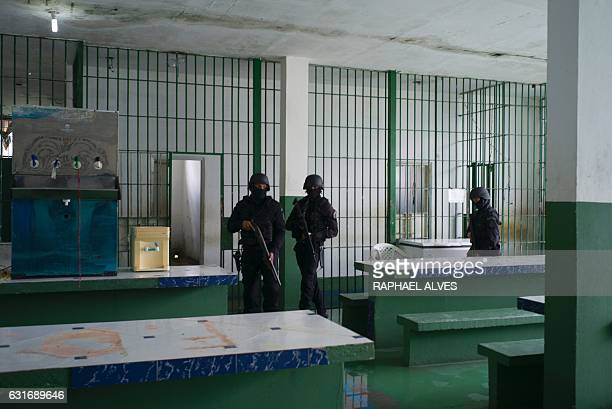 Special Operations Command personnel stand guard in the refectory of the inmates during a visit to the Anísio Jobim Penitentiary Complex where 56...