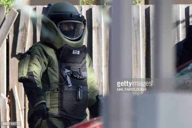 A special operations officer wears a bomb suit at the scene of a shootout in the Melbourne bayside suburb of Brighton on June 6 2017 A fatal shootout...
