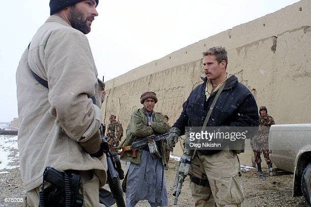 S special operations soldiers talk with Northern Alliance fighters December 3 3001 in Zainiqala near MazariSharif Afghanistan The Northern Alliance...