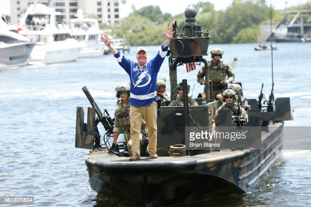 Special operators return to the shore in a Special Operations Craft Riverine after rescuing Tampa mayor Bob Buckhorn playing the roll of a dignitary...