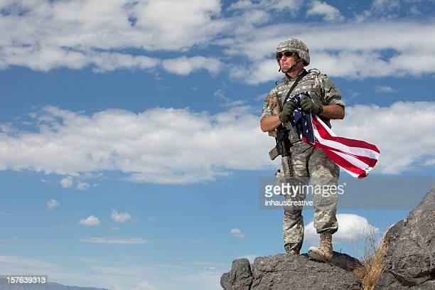Special ops military soldier holding an american flag