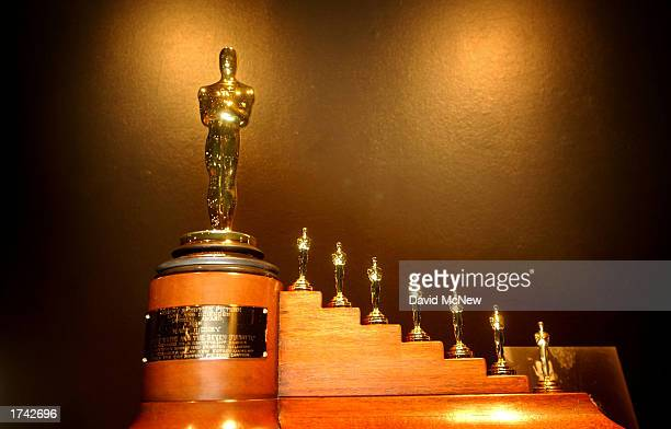 "Special Oscar statuette that was awarded to Walt Disney in 1938 for ""Snow White and the Seven Dwarfs"" that shows an Oscar figure accompanied by seven..."