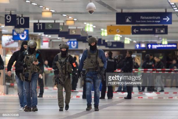 TOPSHOT Special police commandos arrive at the main train station in Duesseldorf western Germany after at least five people where injured by a man...