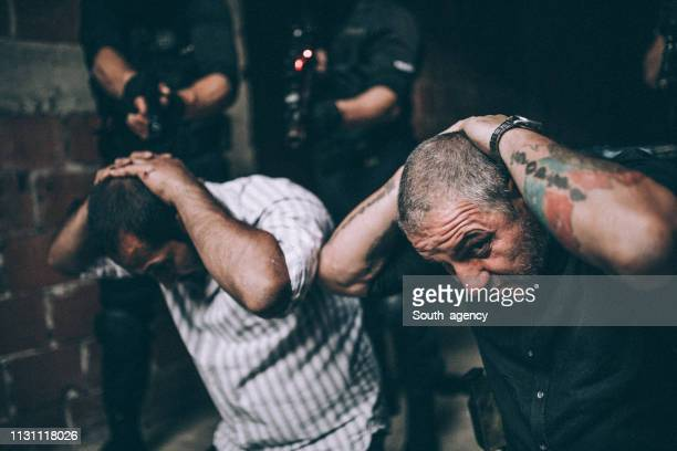 special police force arresting gangsters - gangster stock pictures, royalty-free photos & images