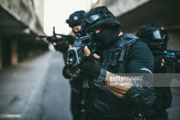 special police force team in action - task force stock pictures, royalty-free photos & images