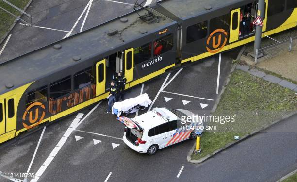 Special Police forces inspect a tram at the 24 Oktoberplace in Utrecht, on March 18, 2019 where a shooting took place. - A gunman opened fire on a...