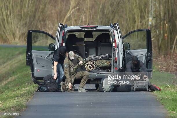 Special police forces prepare an operation near the site where a 80yearold was attacked with a knife on March 10 2017 in Duesseldorf western Germany...