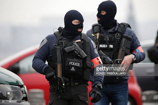 TOPSHOT Special police forces stand guard outside the Council Chamber of Brussels on March 24 2016 during investigations into the Paris and Brussels...