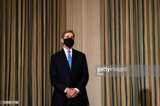 Special Presidential Envoy for Climate John Kerry listens as U.S. President Joe Biden speaks about climate change issues in the State Dining Room of...