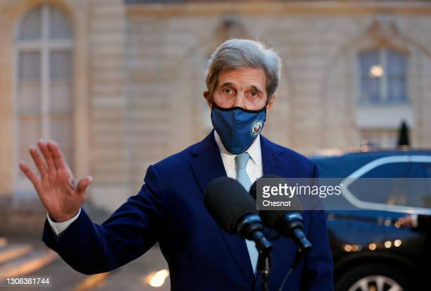 Special Presidential envoy for Climate, John Kerry wearing a protective face mask waves after his statement to the press following his meeting with...