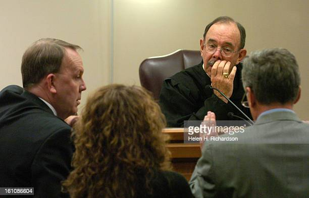 Special Prosceution Tom Quammen left Defense Attorneys Maria Liu and David Wymore approach the bench to speak with Judge Joseph Weatherby as the...
