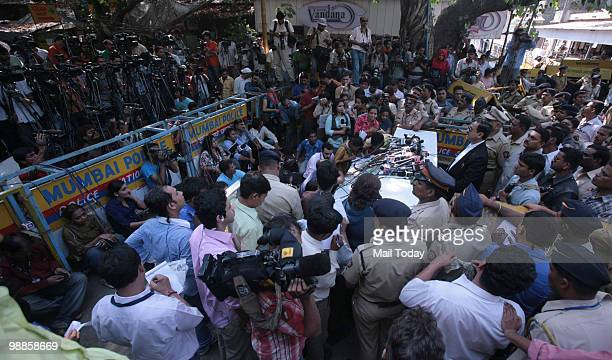 Special Prosecutor Ujjwal Nikam shows a copy of the verdict to the media outside the Arthur Road Jail where the trial of Mohammad Ajmal Kasab the...