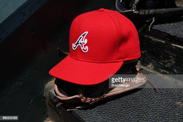 a826a792ee770b ... amazon a special red memorial day baseball hat of the atlanta braves  sits on the dugout