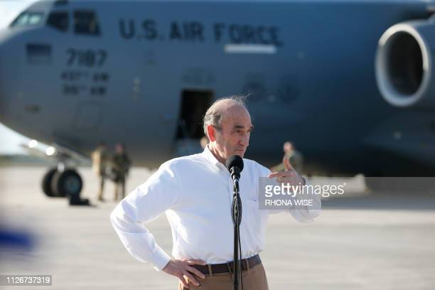 US Special Representative Elliott Abrams speaks with the media before the departure of a C17 cargo plane loaded with food water and medicine for a...
