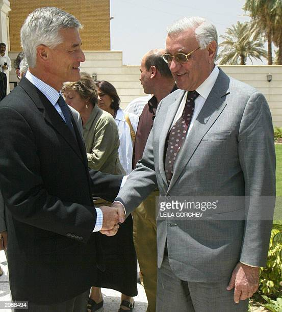 UN special representative for Iraq Sergio Vieira de Mello shakes hands with Iraqi former foreign minister Adnan Pachachi after their meeting in...