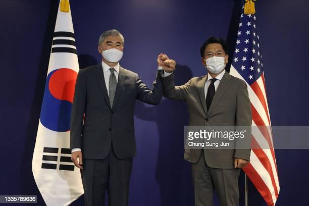 Special Representative for North Korea, Sung Kim bumps elbows with Noh Kyu-duk , South Korea's Special Representative for Korean Peninsula Peace and...