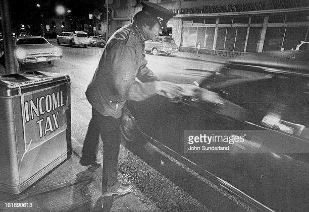 APR 15 1974 APR 16 1974 Special Service Offered Taxpayers US Postal Service employe Kenneth Allen takes an incometax return from the occupant of a...