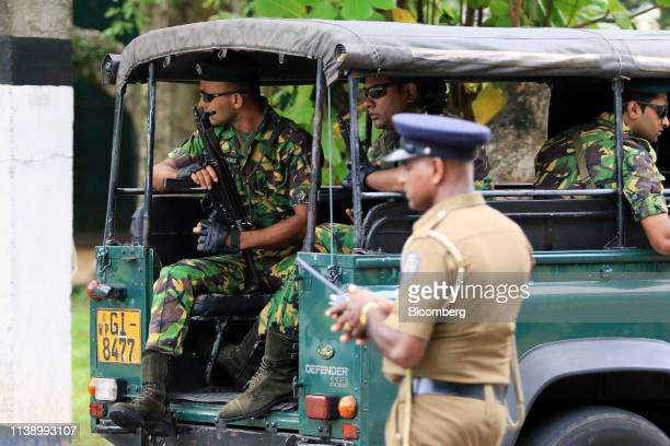 Special Task Force police officers sit in a vehicle arriving at the Parliament of Sri Lanka in Colombo Sri Lanka on Tuesday April 23 2019 In a...
