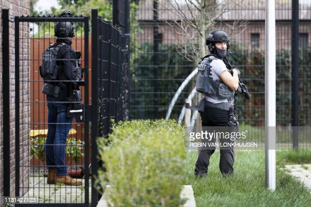 Special task forces of the police stand in the Trumanlaan in Utrecht on March 18 2019 as the police searches the attacker of a tram at the 24...