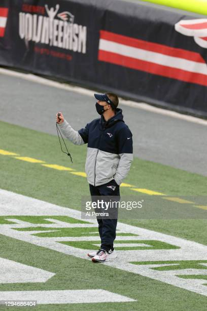 Special Teams Coordinator Cam Achord of the New England Patriots warms up Jake Bailey before the game against the New York Jets at Gillette Stadium...