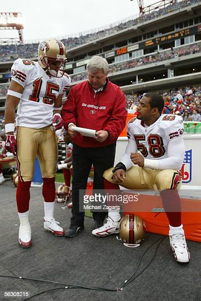 Special teams coordinator Larry Mac Duff meets with wide receiver Jason McAddley and defensive end Corey Smith of the San Francisco 49ers during the...