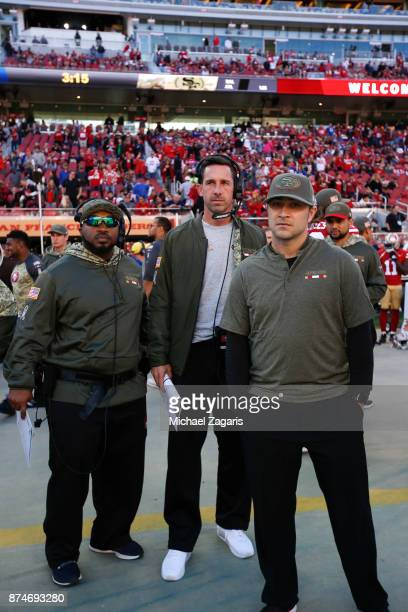 Special Teams Coordinator Richard Hightower Head Coach Kyle Shanahan and Quarterbacks Coach Rich Scangarello of the San Francisco 49ers stand on the...