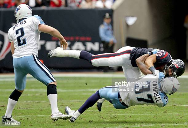 Special teams player Bryan Braman of the Houston Texans wrestle special teams player Tommie Campbell of the Tennessee Titans on a kick off on January...