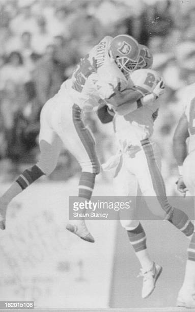 NOV 13 1989 Special to the Denver Post Broncos Tyrone Braxton and Steve Atwater high five after a third of fumble recovery in their victory over...