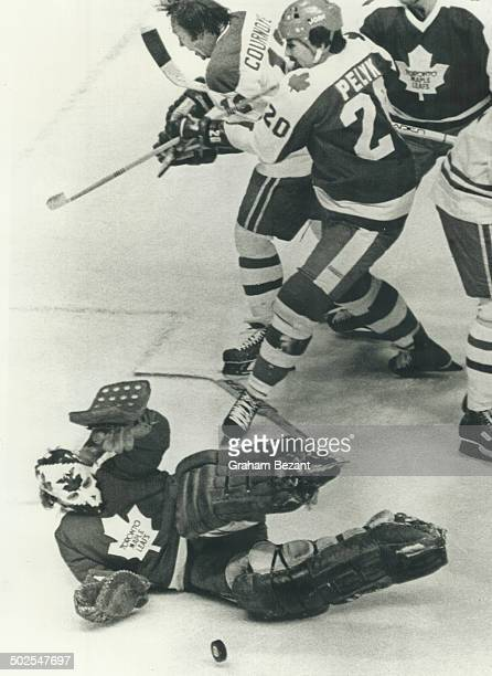 Special to Toronto Star Goal tender Mike Palmateer makes a save against Canadiens speedster Yvan Cournoyer as Mike Pelik mives him out of the play