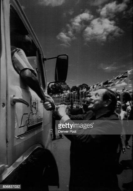 Special Transmission For The Denver Post Unicef chief coordinator James Grant shakes hands with a truck driver convoy of food leaves Nairobi Kenya...