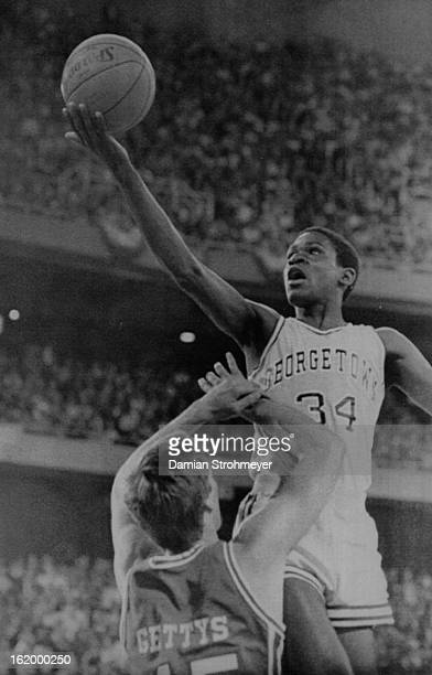APR 3 1984 Special Transmission for the Denver PostGeorgetown's Reggie Williams goes up and over Reid Gettys of Houston during firsthalf action in...