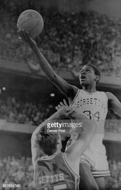 Special Transmission for the Denver PostGeorgetown's Reggie Williams goes up and over Reid Gettys of Houston during firsthalf action in the NCAA...