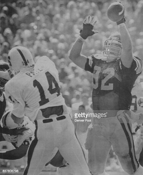 Attn Gert Myers USC nose guard Tony Colorito reaches up to block pass by Stanford quarterback John Paye at the Coluseum 101985 Los Angeles Times...