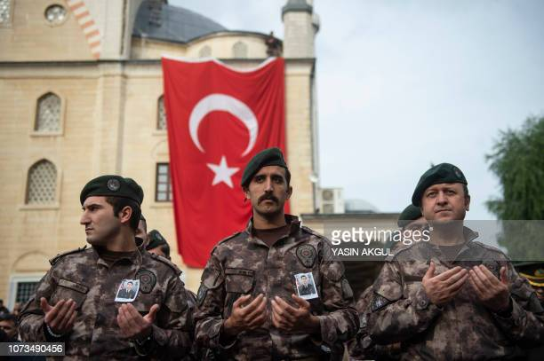 Special Turkish police pray during the funeral of Muhammed Ali Kalo a Turkish soldier who was killed during the operation against Syria's Afrin...