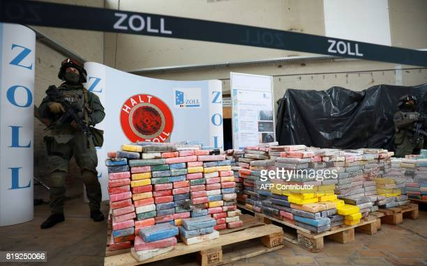 Special unit customs officers stand next to a pallets with cocaine packets during a press conference on July 20 2017 in Hamburg 38 tons of cocaine...