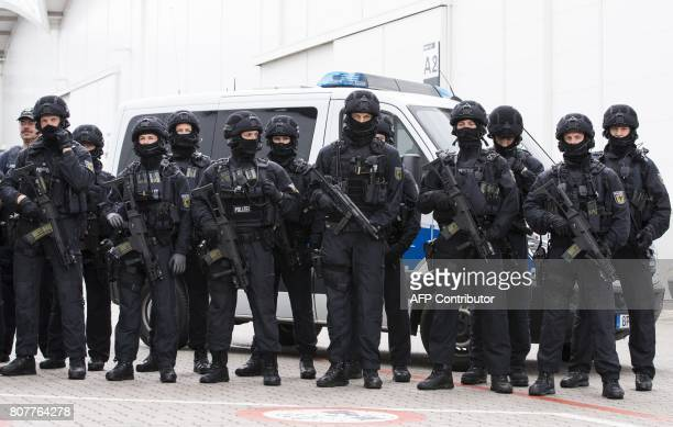 A special unit of the Federal police poses for the media on July 4 2017 at the Messehallen convention centre in Hamburg northern Germany the venue of...