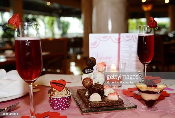Special Valentine pralines and cakes are displayed for a Romantics Valentine Dinner at Sheraton Hotel on February 10 2014 in Surabaya Indonesia Roses...