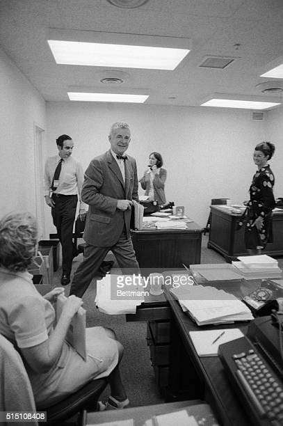 Special Watergate prosecutor Archibald Cox strides into his permanent offices here Cox and his staff had been working out of the Justice Department...