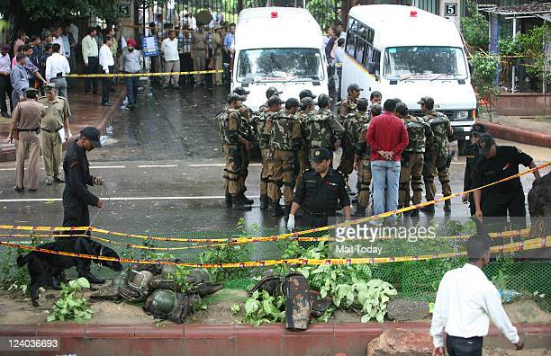 Special Weapons And Tactics members from the Delhi police keep vigil as NIA team looks for eveidence after cordoning off the site of a bomb blast...