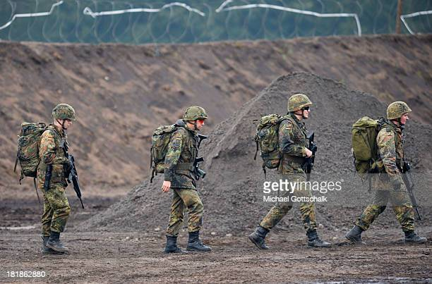 Specialised armed soldiers of a regiment of pioneers of the Bundeswehr Infantrie Force walk throug a Forward Operating Base during a maneuver of the...
