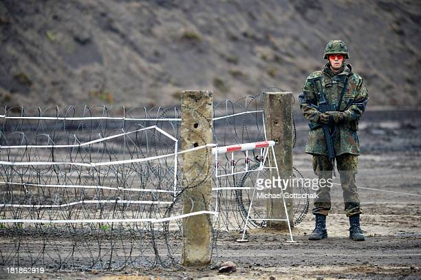 Specialised soldier of a regiment of pioneers of the Bundeswehr Infantrie Force guards the entrance of a Forward Operating Base during a maneuver of...