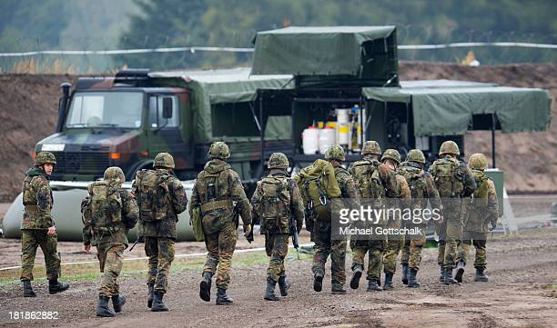 Specialised soldiers of a regiment of pioneers of the Bundeswehr Infantrie Force walk throug a Forward Operating Base during a maneuver of the German...