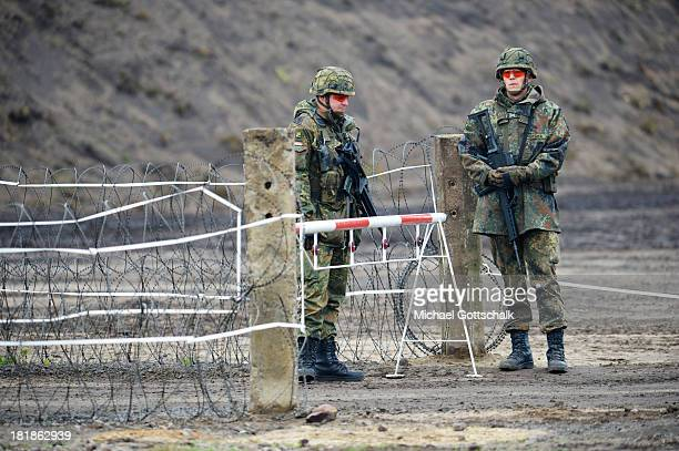 Specialised soldiers of a regiment of pioneers of the Bundeswehr Infantrie Force guard the entrance of a Forward Operating Base during a maneuver of...