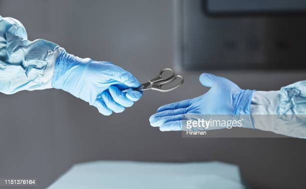 specialising in cutting edge surgery - surgeon stock pictures, royalty-free photos & images