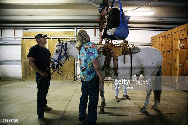 Specialist Andrew W. Soule learns to ride a horse, part of a series of choices he made as to which sports he wanted to pursue as part of a week of...