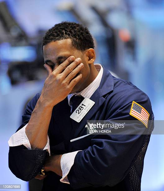 Specialist Bernard L Wheeler of Knight Captial Americas LP works on the floor of the New York Stock Exchange on August 4 2011 The Dow Jones...