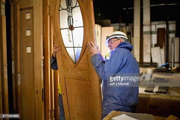 Specialist carpenters from JCG work on a door of the Mackintosh Building on November 22 2017 in Glasgow Scotland Restoration of Glasgow School of Art...