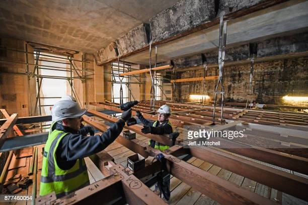 Specialist carpenters from Lawrence McIntosh hold a drill as they install the floor to the bookstore above the Mackintosh Library on November 22 2017...