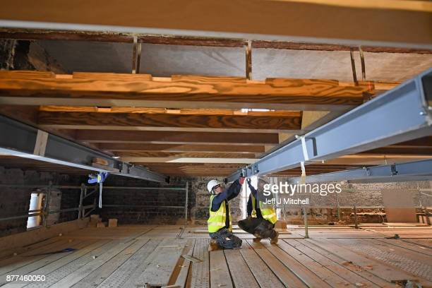 Specialist carpenters from Lawrence McIntosh work on a beam as they install the floor to the bookstore above the Mackintosh Library on November 22...